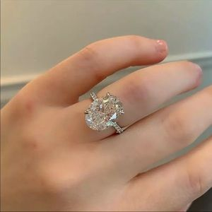 Jewelry - Stunning large oval CZ with a pave setting
